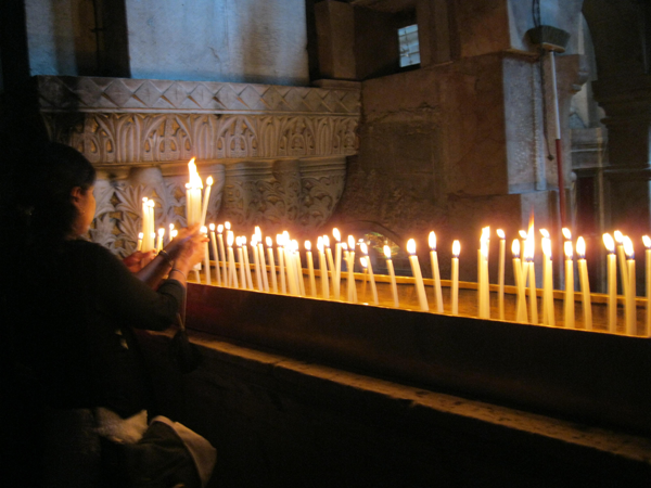 Laying Candles In The Holy Citadel In The Old City Of Jerusalem
